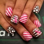 Pink and brown with white polka dot nail art design