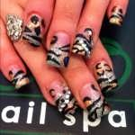 Gold and Silver Animal Print Nail Art Design